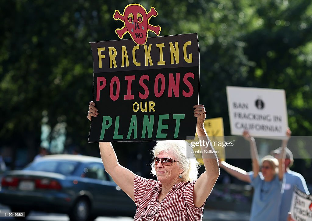 Protestors hold signs against fracking during a demonstration outside of the California Environmental Protection Agency (EPA) headquarters on July 25, 2012 in Sacramento, California. Dozens of environmental activists staged a 'Stop Fracking With California' demonstration outside the California EPA headquarters ahead of public workshop hosted by the Division of Oil Gas and Geothermal Resources where protestors are planning to voice their opposition to the rushed regulatory of fracking and the many threats to the environment imposed by the process of hydraulic fracking for oil and gas.