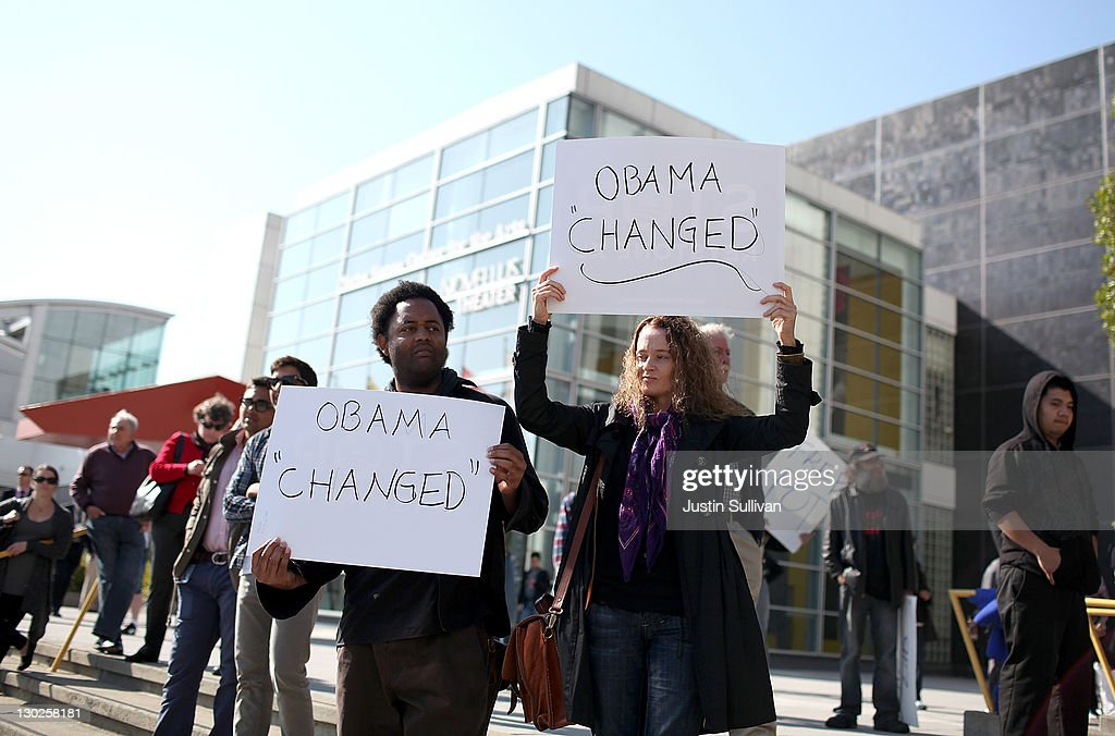 Protestors hold signs as they demonstrate outside of the W Hotel where U.S. President Barack Obama is holding a fundraiser on October 25, 2011 in San Francisco, California. Hundreds of protestors from a wide variety of activist groups staged protests outside of the W Hotel where President Obama was holding a $7,500 per person fundraiser.