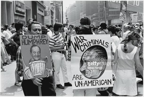 Protestors hold signs at an antiwar rally in New York New York Fall 1968 The visible signs read 'Dump Humphrey' which shows a photograph American...