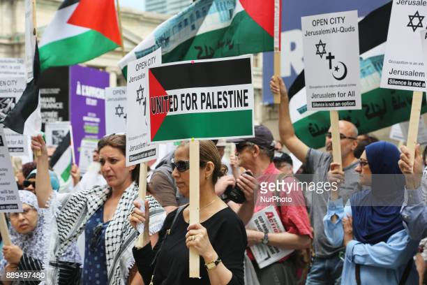 Protestors hold signs during a demonstration in Toronto Canada on July 29 to protest against Israel and to show solidarity with Palestine Israel had...