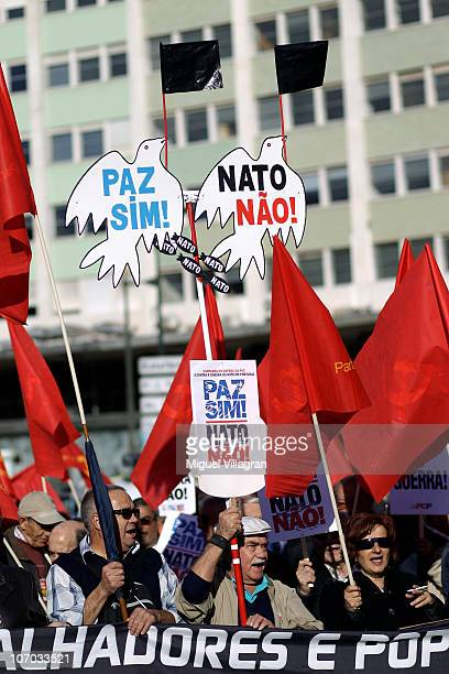 Protestors hold signs reading Peace without Nato during a demonstration against the NATO summit on November 20 2010 in Lisbon Portugal Thousands of...