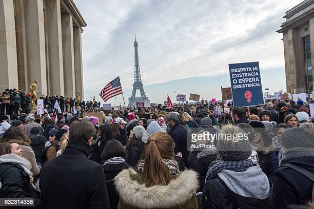 Protestors hold up anti Trump signs as over 2000 people protest during the Women's march on the Trocadero in front of the Eiffel Tower march on...