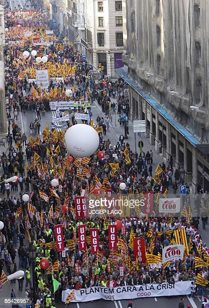 Protestors hold up banners with the slogan 'facing up to crisis' during a demonstration in the center of Barcelona on March 14 2009 to protest at the...