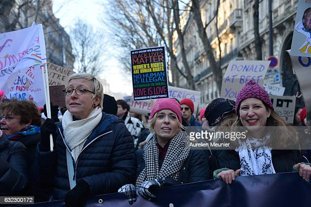 Protestors hold up signs as over 2000 people protest during the Women's march in front of Trocadero on January 21 2017 in Paris France The Women's...