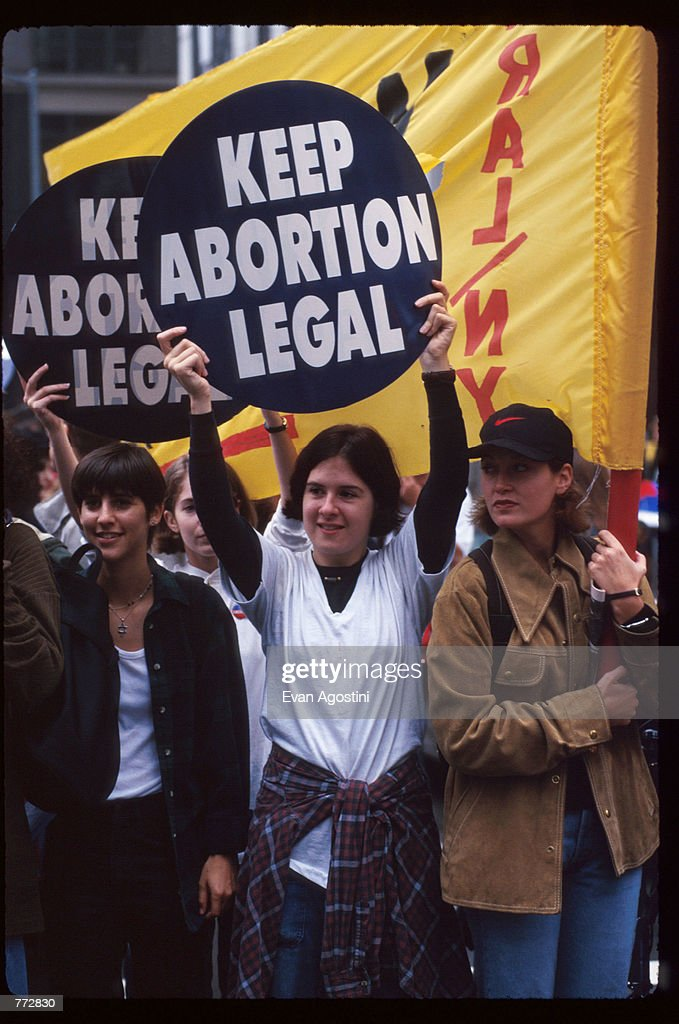 Protestors hold up signs at the Women's Rights rally October 7, 1995 in New York City. The rally protested the arrival of Pope John Paul II, whose conservative doctrine on issues such as abortion, sex, and homosexuality contradict the ideology of many women's rights groups.