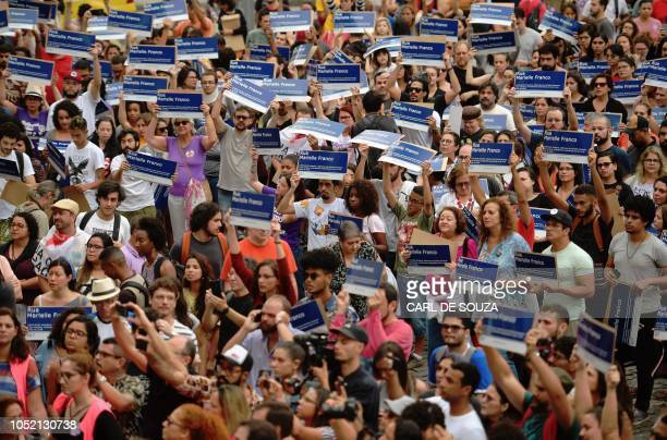 TOPSHOT Protestors hold up street signs reading Marielle Franco St during a demonstration in the centre of Rio de Janeiro on October 14 2018 1000...
