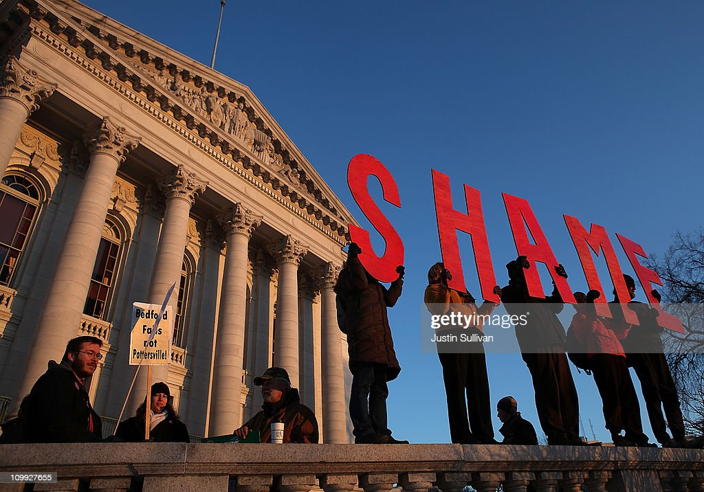 Protestors hold wooden letters that spell the word 'shame' in front of the Wisconsin State Capitol on March 10, 2011 in Madison, Wisconsin. Thousands of demonstrators continue to protest at the Wisconsin State Capitol as the Wisconsin House voted to pass the state's controversial budget bill one day after Wisconsin Republican Senators voted to curb collective bargaining rights for public union workers in a surprise vote with no Democrats present.
