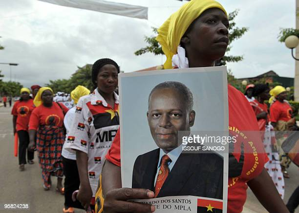 Protestors holding pictures of Angolan President Jose Eduardo Dos Santos demonstrate in a march against last week's separatist shooting that killed...