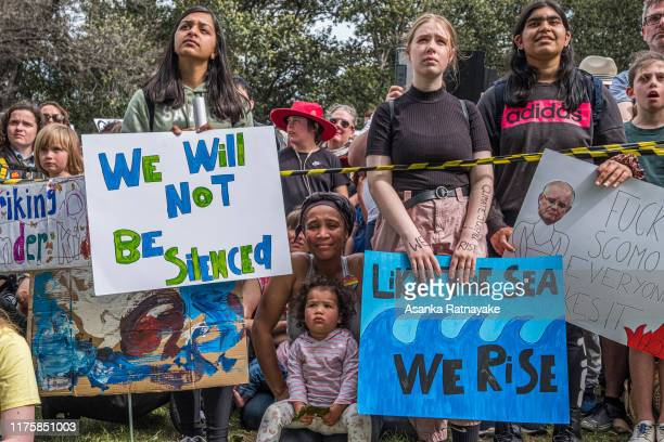 Protestors holding placards look on on September 20, 2019 in Melbourne, Australia. Rallies held across Australia are part of a global mass day of...
