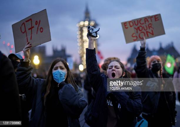 Protestors holding placards march on to Westminster Bridge as they demonstrate against the Government's Police, Crime, Sentencing and Courts Bill,...