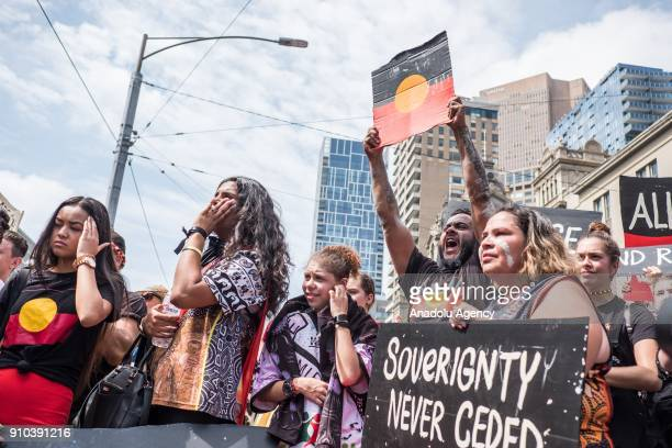 Protestors holding placards shouting chants during a protest by Aboriginal rights activist on Australia Day in Melbourne Australia 26 January 2018...