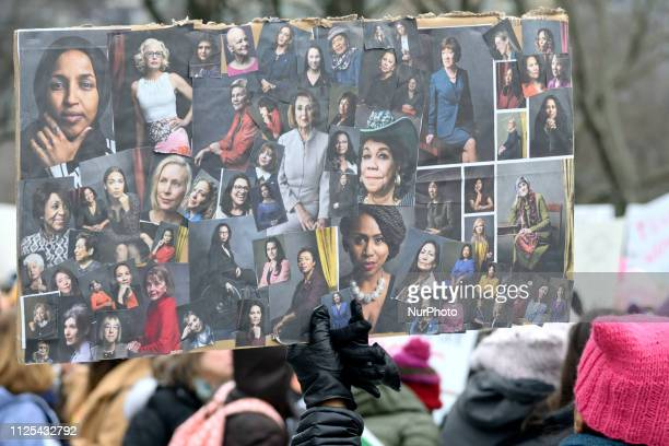 Protestors holds up a sign during the January 19 2019 Women's March on the Benjamin Franklin Parkway in Philadelphia PA