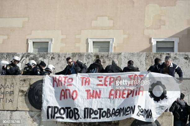 Protestors hung a large banner outside the Greek Parliament during the demonstration against the voting of the new Multibill of the third evaluation
