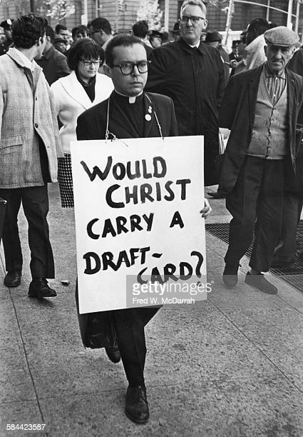 A protestors in a clerical clothing carries a placard during an antiViet Nam War demonstration near Foley Square New York New York October 27 1965...
