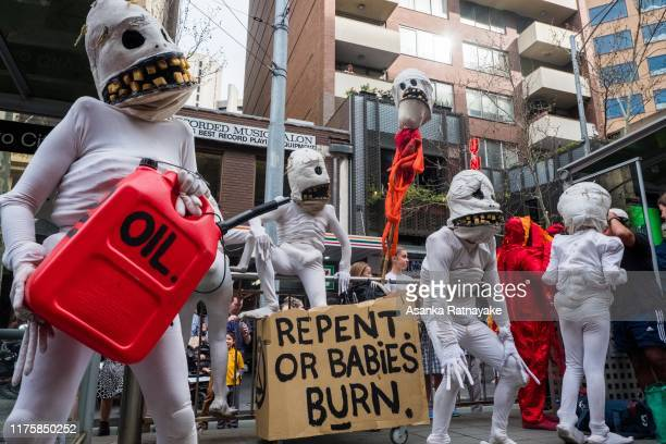Protestors in costumes holding a fake Oil canister on September 20 2019 in Melbourne Australia Rallies held across Australia are part of a global...