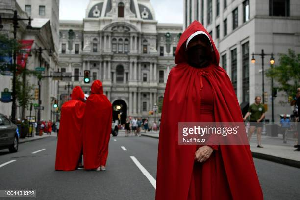 Protestors in Handsmaids Tale attire stand in the middle of South Broad Street outside a fundraiser attended by Vice President Mike Pence and Lou...
