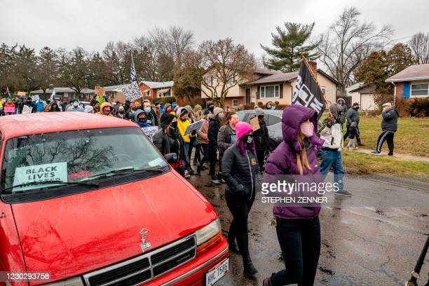 Protestors in support of Black Lives Matter march and chant during a demonstration against the police killing of Andre Hill in the neighborhood where...