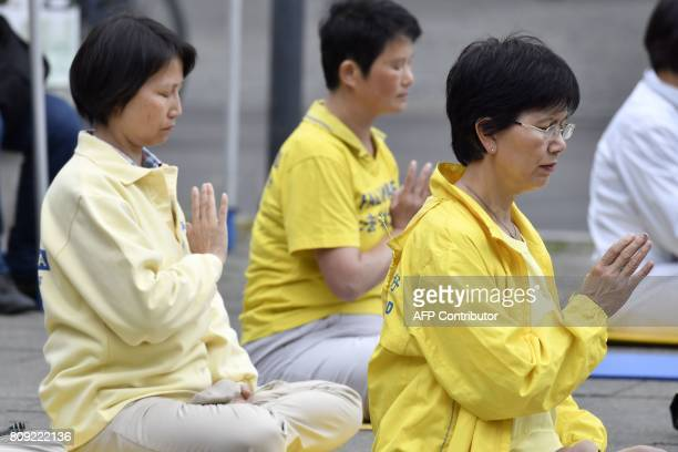 Protestors in support of the practice of Falun Dafa demonstrate outside the Zoologischer Garten in Berlin as the German Chancellor and the Chinese...