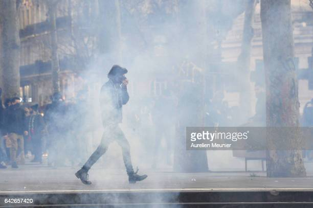 Protestors in tear gas during a anti police brutality demonstration on February 18 2017 in Paris France Violent protests have broken out across...