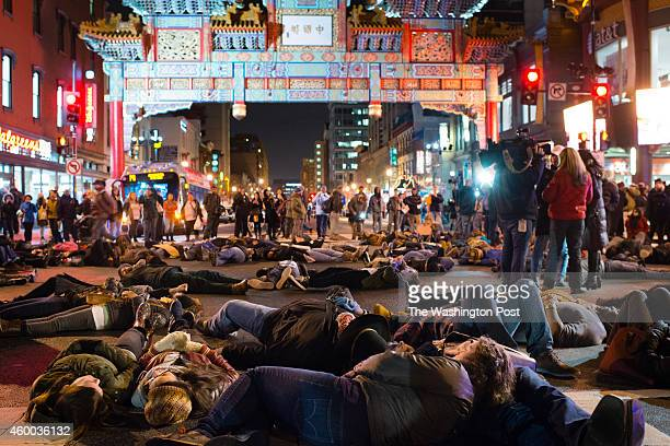 Protestors in Washington DC march in Chinatown on the evening of Friday December 5 2014 in protest against police brutality and for justice They are...