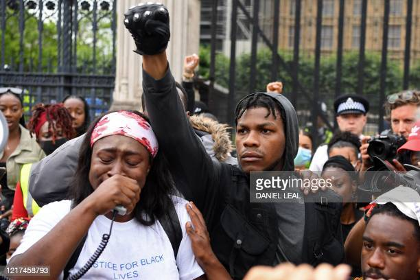 Protestors including British actor John Boyega stand in Parliament square during an antiracism demonstration in London on June 3 after George Floyd...