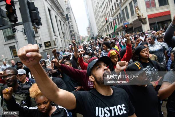 Protestors join a march for the police shooting of Antwon Rose during a Juneteenth celebration on June 23 2018 in Pittsburgh Pennsylvania Rose an...