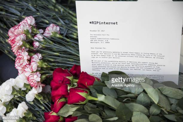 Protestors laid flowers and notes outside of the Federal Communications Commission headquarters after the FCC repealed the Obama era regulations...