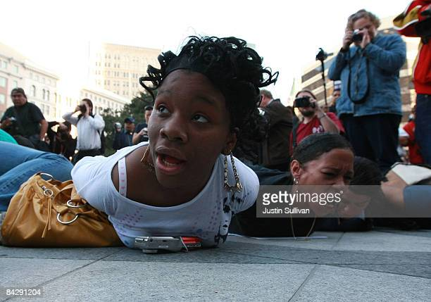 Protestors lay on the ground and yell 'don't shoot' during a demonstration for slain 22yearold Oscar Grant III January 14 2009 in Oakland California...