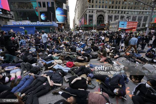 Protestors lay on the ground with their hands behind their back in a call for justice for George Floyd in Times Square on June 1 during a Black Lives...