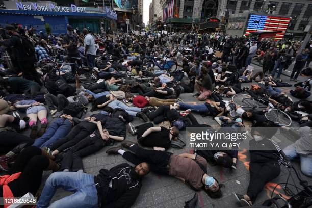 TOPSHOT Protestors lay on the ground with their hands behind their back in a call for justice for George Floyd in Times Square on June 1 during a...