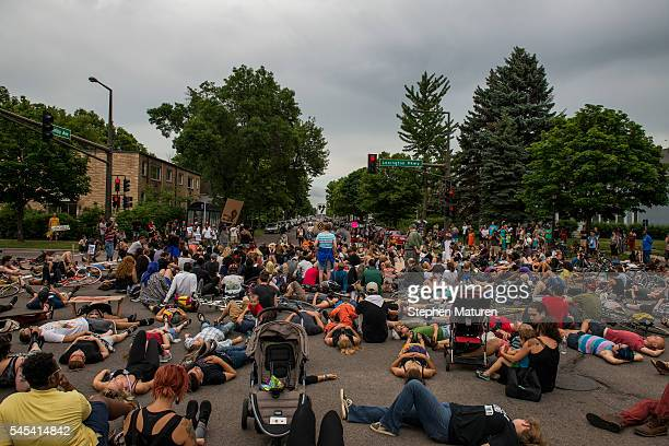 Protestors lie in an intersection during a demonstration for Philando Castile on July 7 2016 in St Paul Minnesota Castile was shot and killed by a...