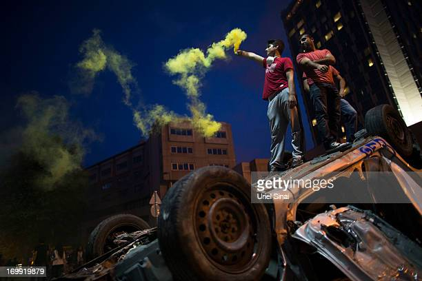Protestors ligt torches in Taksim Square on June 4 2013 in Istanbul Turkey The protests began initially over the fate of Taksim Gezi Park one of the...
