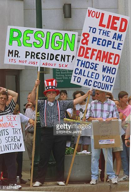 Protestors line the street outside the Mechanics Hall where US President Bill Clinton spoke to the Worcester community MA 27 August Clinton in his...