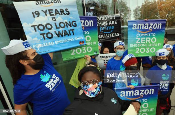 Protestors line up as Andy Jassy the CEO of Amazon speaks at the ceremonial ribbon cutting prior to tomorrow's opening night for the NHL's newest...