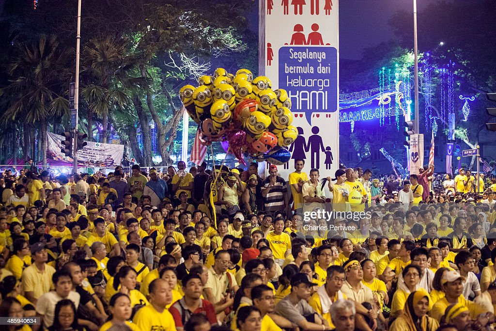 Protestors listen to speeches during the Bersih 4.0 rally on August 30, 2015 in Kuala Lumpur, Malaysia. Prime Minister Najib Razak has become embroiled in a scandal involving state fund debts and allegations of deposits totaling 2.6 billion ringgit paid to his bank account. Razak has denied any wrongdoing. Thousands of people gathered to demand his resignation and a new general election.