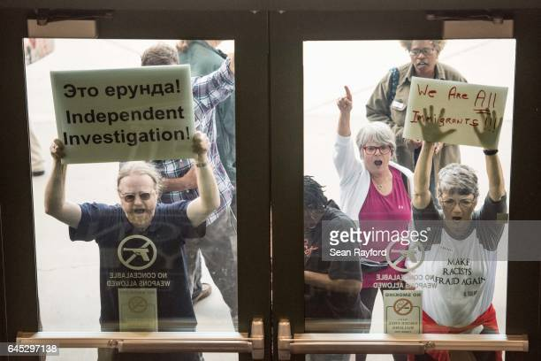 Protestors make noise outside of a town hall meeting with Sen. Tim Scott , at the Charleston County Council Chambers on February 25, 2017 in North...