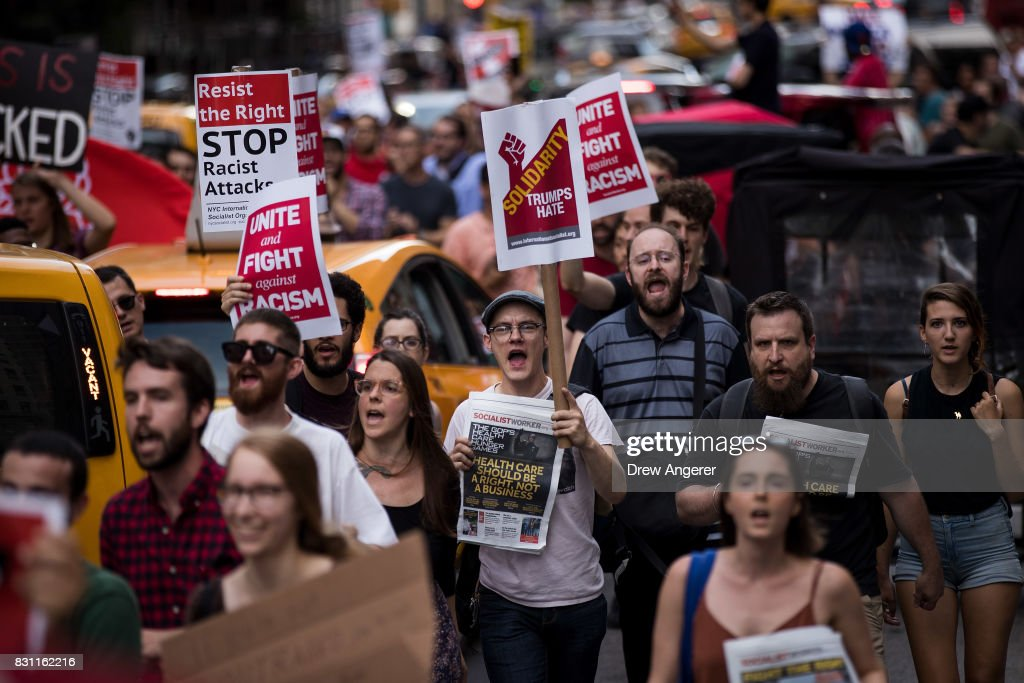 Protestors make their way north on Fifth Avenue as they march against white supremacy and racism, August 13, 2017 in New York City. 32-year-old Heather Heyer was killed in Charlottesville on Saturday when a car driven by a white supremacist barreled into a crowd of counter-protesters following violence at the Unite the Right rally.