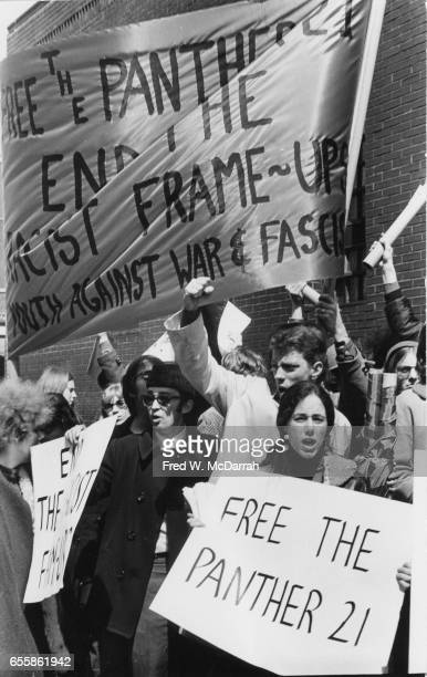 Protestors many with signs demonstrate in support of the Black Panthers Party near the Federal courthouse New York New York April 5 1969 Among the...