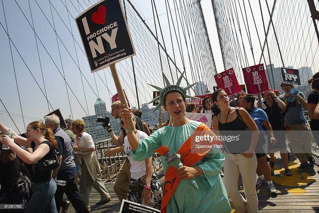 Protestors march across the Brooklyn Bridge in support of a women's right to choose August 28, 2004 in New York City. The pro-choice anti-Bush march is one of numerous demonstrations planned in New York this week in a reaction to the Republican National Convention taking place in Manhattan.