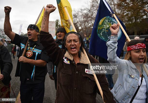 Protestors march against the Dakota Access Pipeline in Pasadena California on January 2 2017 after the Rose Parade Protestors calling for Wells Fargo...