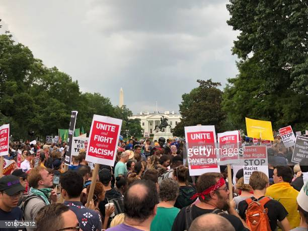 Protestors march against the farright's Unite the Right rally August 12 2018 in Washington DC on the oneyear anniversary of deadly violence at a...
