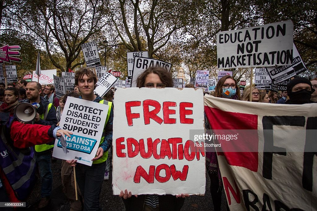 Protestors march along Millbank during a protest against education cuts and tuition fees on November 4, 2015 in London, England. University students from across the country are marching on the streets of London to protest against cuts to free education. After a rally outside what was the University of London Union, the march will take in Parliament Square, Millbank - occupied by student protesters five years ago - and end in front of the Department for Business, Innovation and Skills (the department responsible for universities).