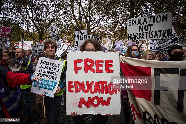 Protestors march along Millbank during a protest against education cuts and tuition fees on November 4 2015 in London England University students...