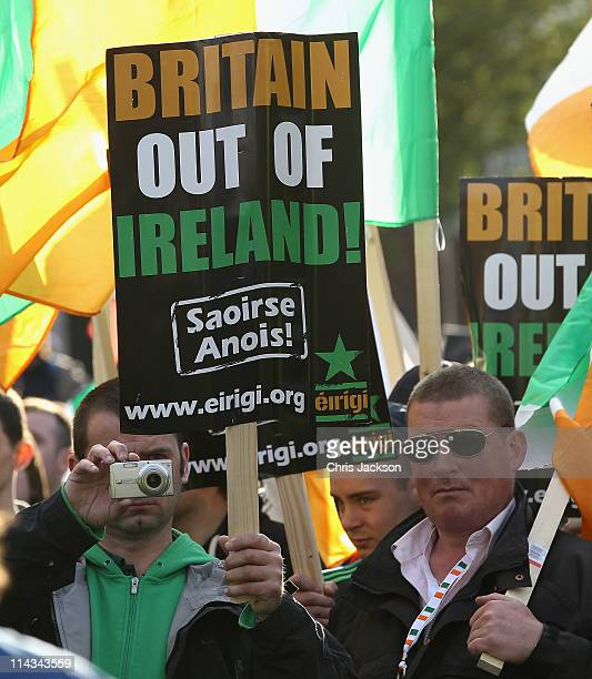 Protestors march as the Queen attends a state dinner in Dublin Castle on May 18 2011 in Dublin Ireland The Duke and Queen's visit to Ireland is the...