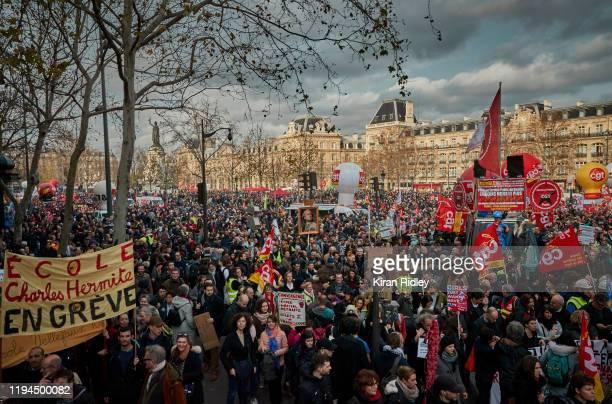 Protestors march at Place de la Republique as thousands take to the streets as strikes in France enter their third week with new unions joining the...