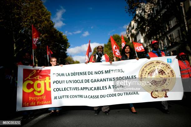 Protestors march behind banners during a demonstration called by the General Confederation of Labour French worker's union in Paris on October 19...
