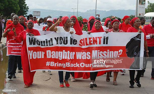 Protestors march by shouting slogans under ''Bring back our girls'' campaign for the missing Nigerian girls in Abuja Nigeria on August 22 2014 On...