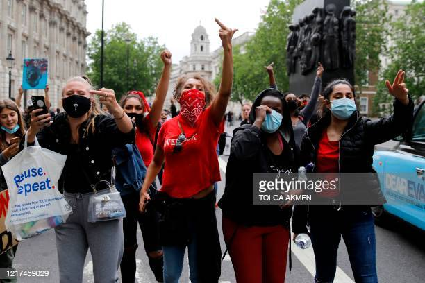 Protestors march down Whitehall during an antiracism demonstration in London on June 3 after George Floyd an unarmed black man died after a police...