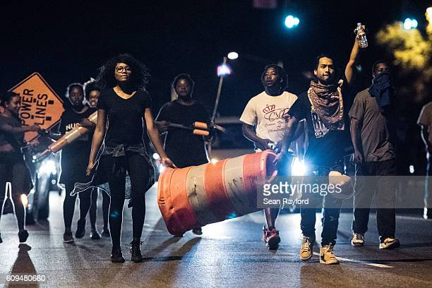 Protestors march down WT Harris Blvd September 21 2016 in Charlotte NC The protests began the previous night following the fatal shooting of...