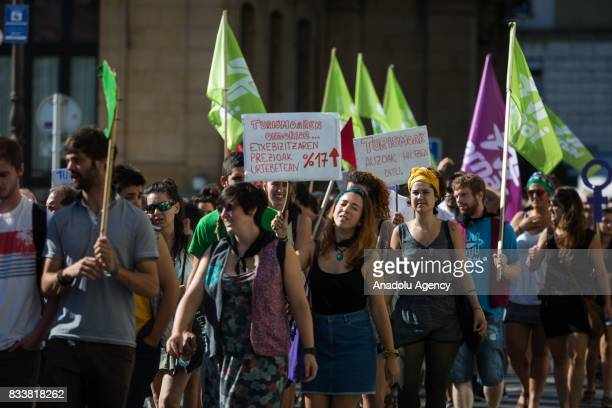 Protestors march during a demonstration against tourists as they hold placards in San Sebastian Spain on August 17 2017 Hundreds of activists stage a...